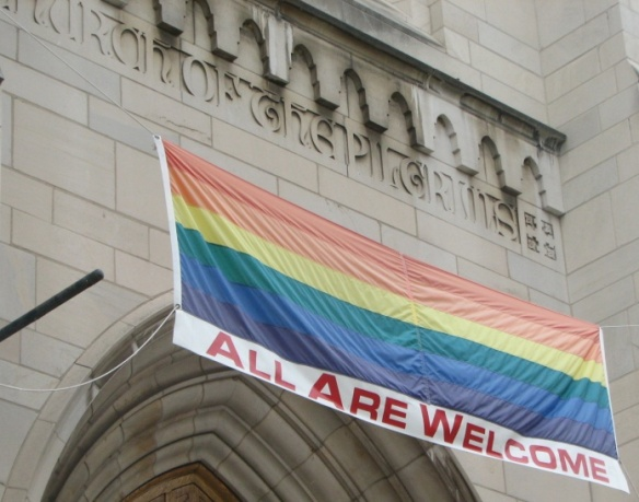 Portal of the Church of Pilgrims, in Washington, DC, with a LGBT banner.